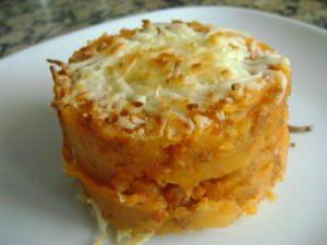 Preparar patatas dulces con queso al horno